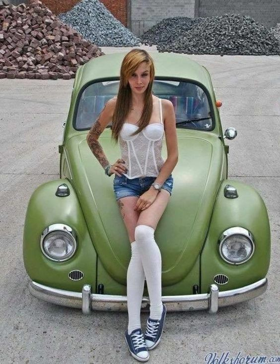 Nice looking girl Loves her olive green vw beetle
