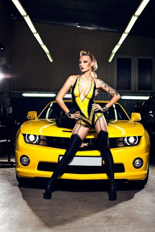 Yellow Chevrolet Camaro with girl in Yellow