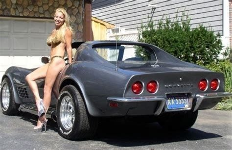 cute women leaning on a   64 Corvette chevy