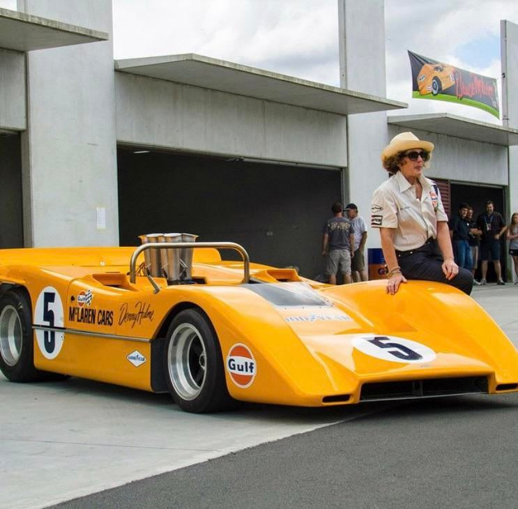 Jan McLaren sitting on Denny Hulme's McLaren M8a