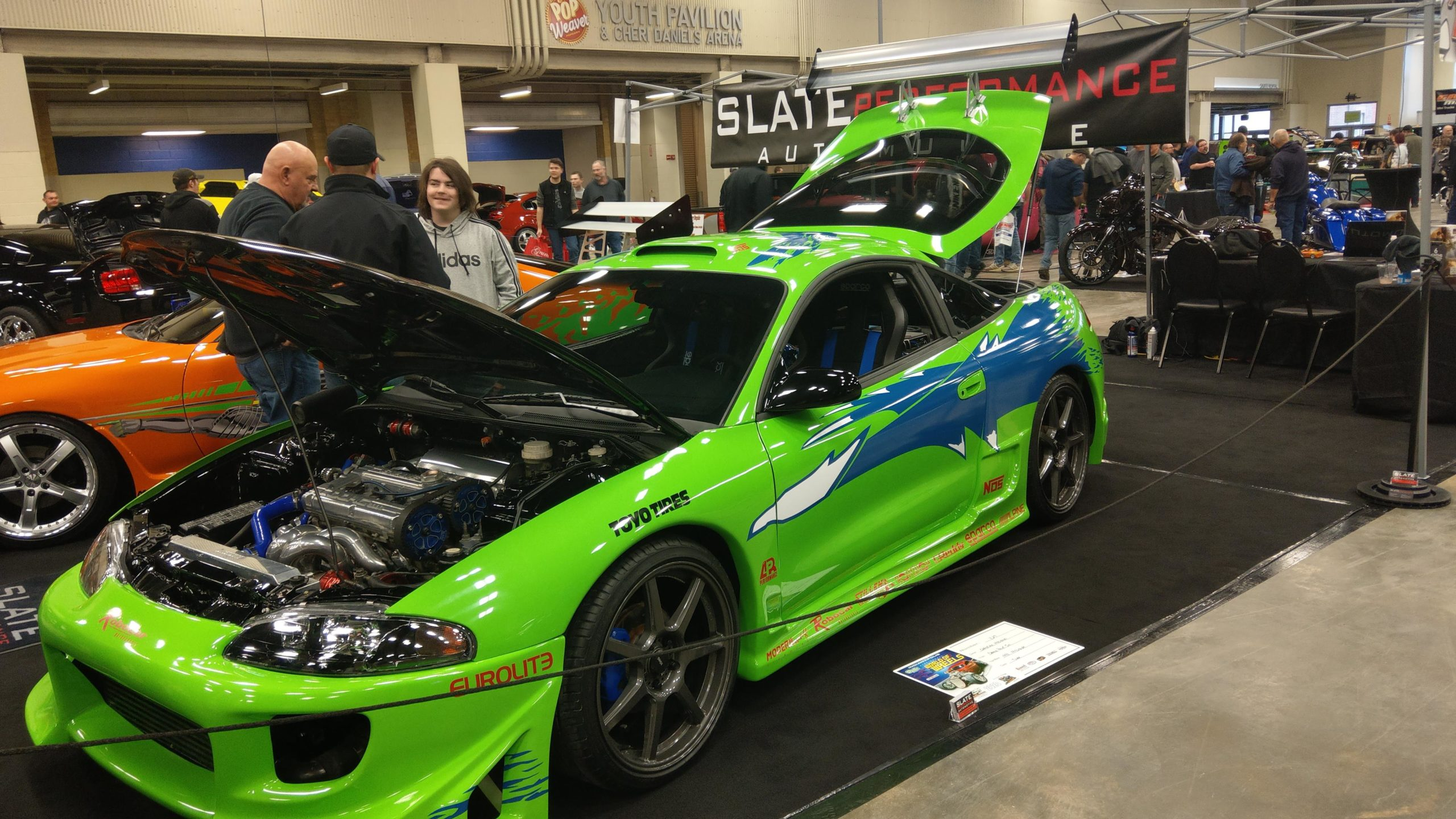 The fast and furious Mitsubishi Eclipse and next to it is the Toyota Supra