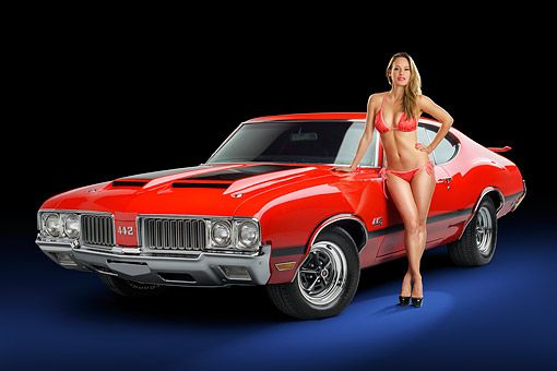 WMN 03 RK0390 01 © Kimball Stock 1970 Oldsmobile 442 Red 3/4 Front View In Stud…
