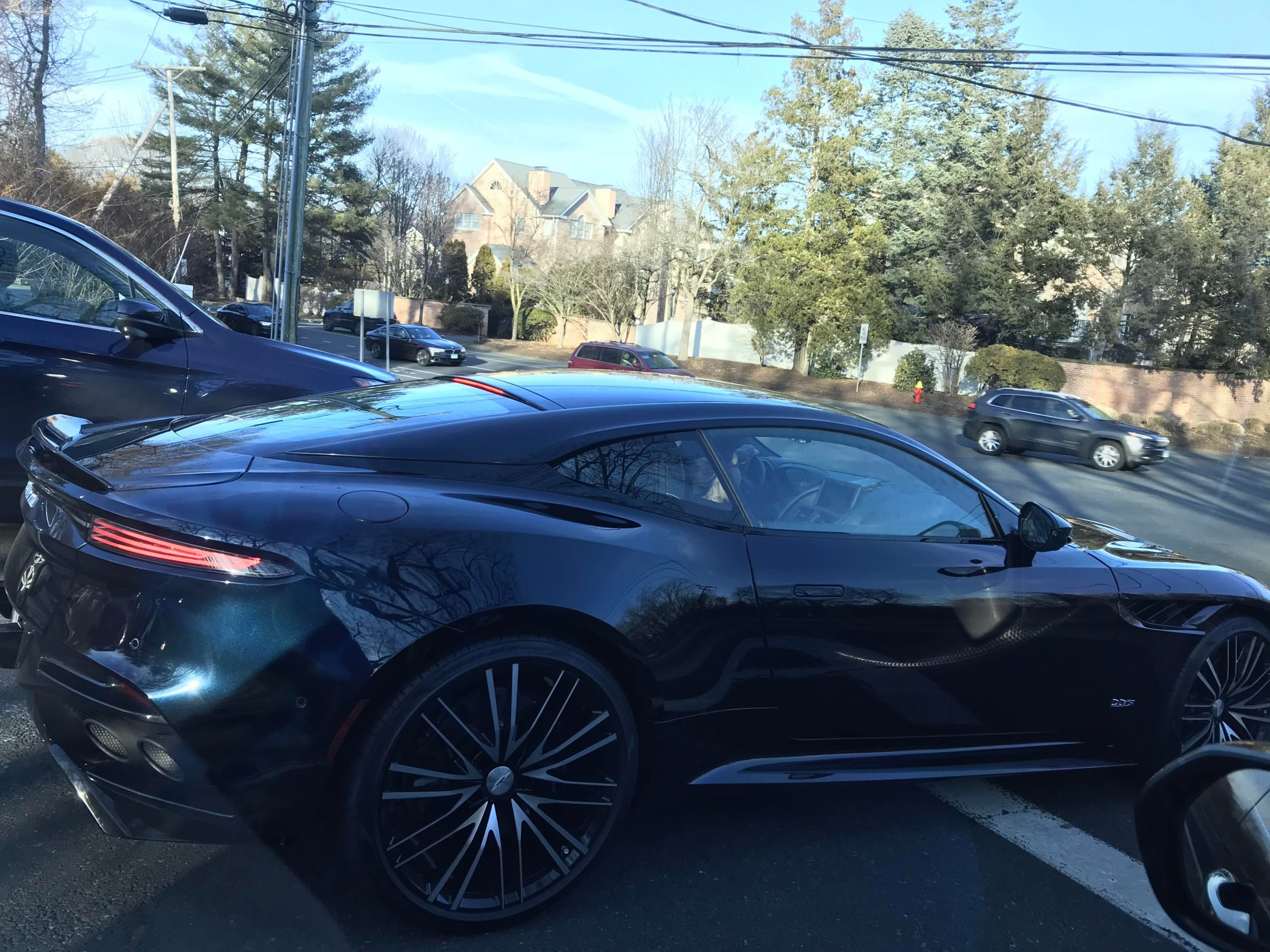 Best shot I could get through tinted windows without looking like a creeper! Sick Aston Martin, anyone know the model?