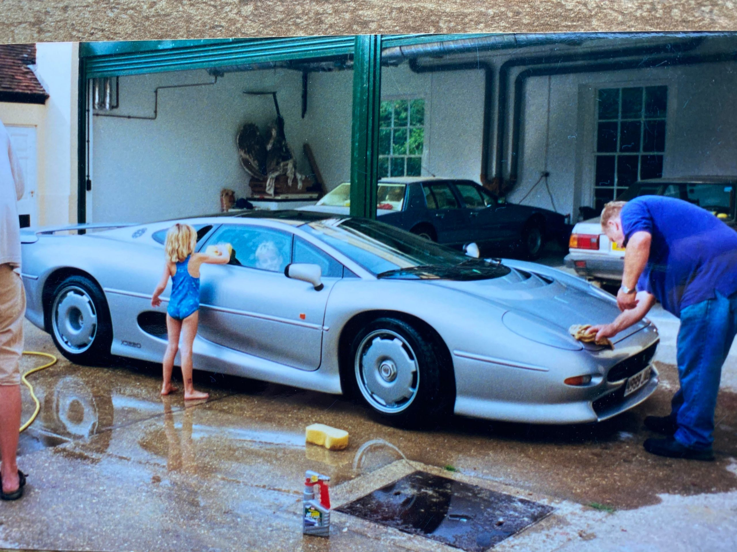 Me when I was 6 behind the wheel of XJ 220, gettin a wash. Circa 2000